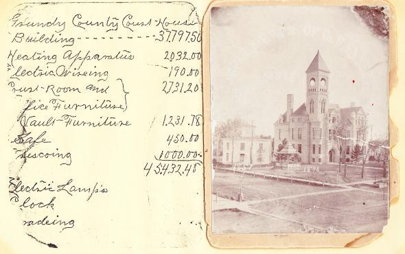 The picture shows the current Courthouse with the original 'Cheesebox' Courthouse.  The current Courthouse cost was $45,432.48 in 1891.
